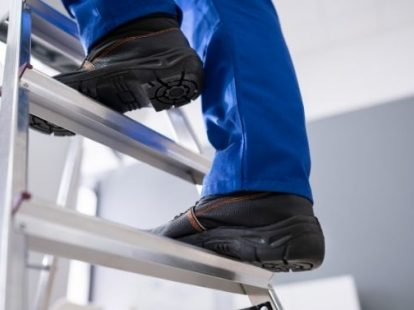 handyman up a ladder